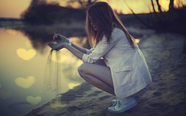 Girl-Reflecting-while-Playing-with-Sand-600x375